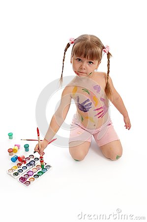 Little girl with paints and a brush