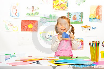 Little girl with paper cloud