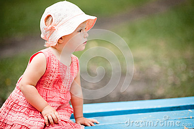 Little Girl on Park Bench