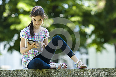 Little girl with PC tablet
