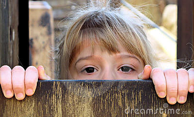 Little Girl Peeking Over Fence