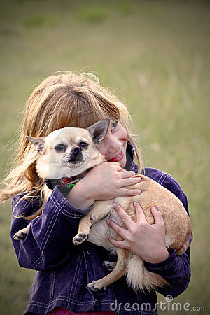 Little girl with pet Chihuahua