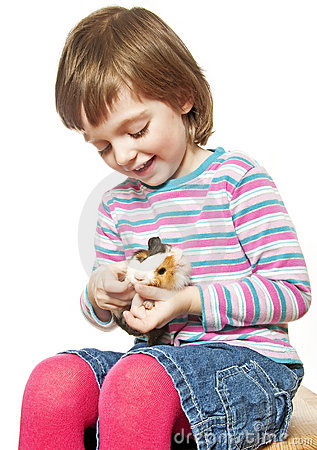 Little girl  with pet guinea pig