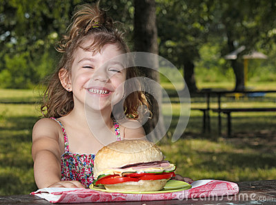 Little girl picnic in park