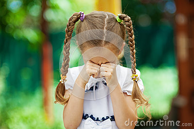 Little girl with pigtails crying