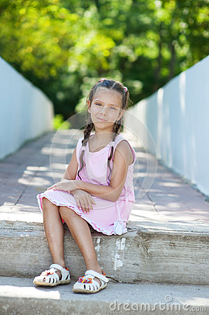 Little girl with pigtails sitting