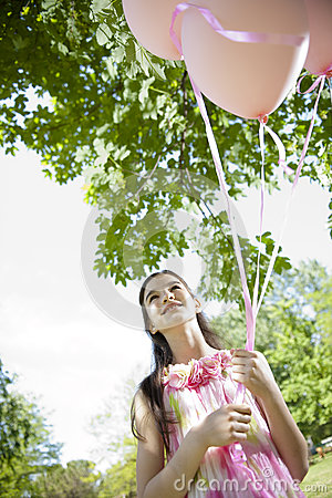 Little girl with pink balllons