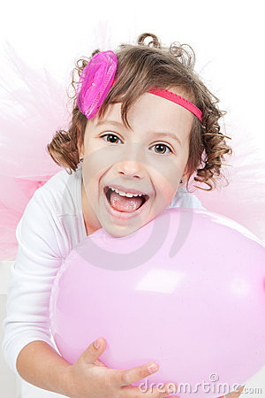 Little girl with pink balloon in studio