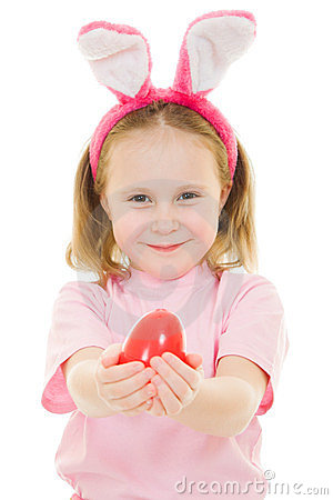 The little girl with pink ears bunny with an egg