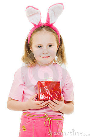 The little girl with pink ears bunny with a gift