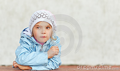 Little girl in pink hat and jacket