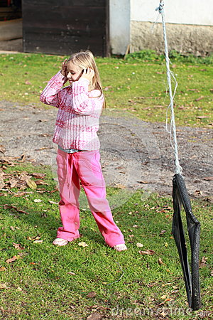 Little girl in pink holding ears