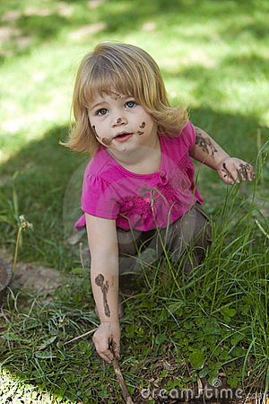 Little girl in pink with muddy face