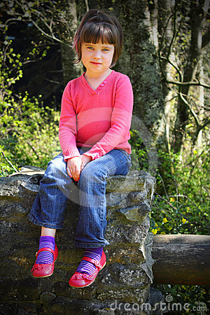 Little girl in pink shoes