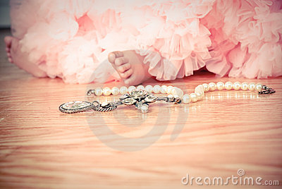 Little girl in pink tulle tutu with pearls