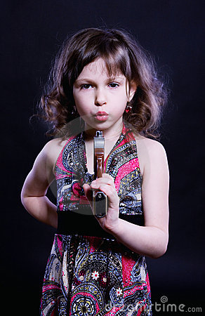 Little girl with pistol