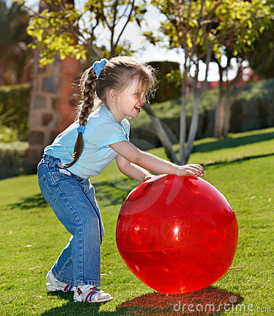 Little Girl Play With  Ball In The Park Royalty Free Stock Photo - Image: 18217555