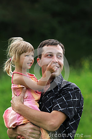 Little girl play with dad in nature