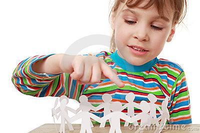 Little girl play with garland of paper creatures