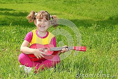 Little girl play guitar