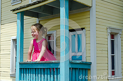 little girl in a play house