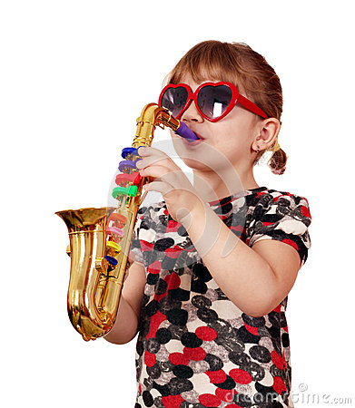 Little girl play saxophone