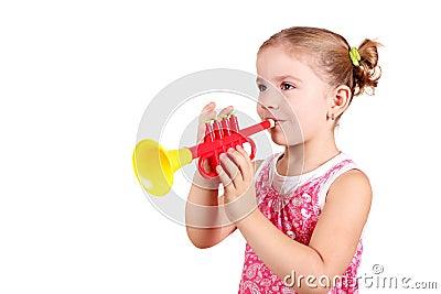 Little girl play trumpet