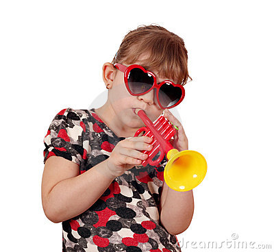 Little girl with play trumpet