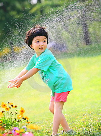 Little girl play water