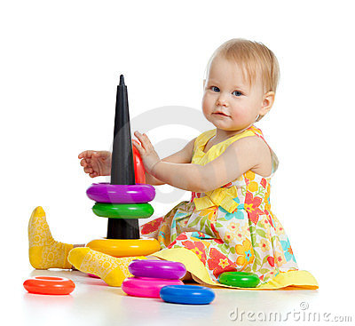 Little girl playing with color toy