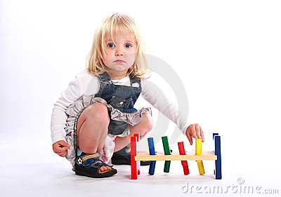 Little girl playing a colorful toy Stock Photo