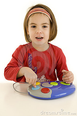 Little girl playing computer games