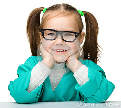 Little girl is playing doctor