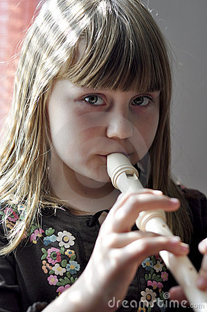 Little girl playing the flute