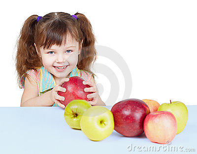 Little girl playing with fruits sitting at table