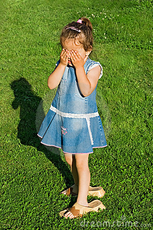 Little girl playing hide-and-seek