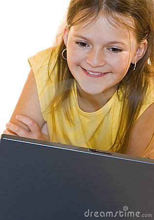 Little girl playing on laptop