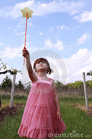 Little girl playing with magic wand