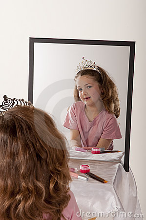 Little girl playing make-up and fairy princess