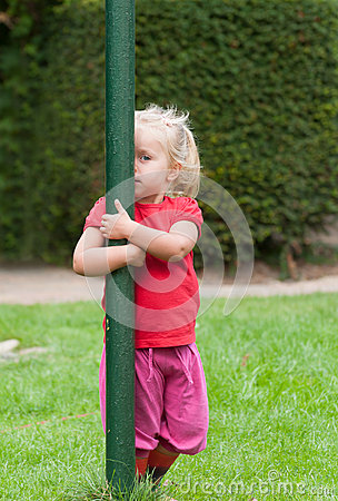 Free Little Girl Playing Peek-a-boo Royalty Free Stock Photo - 26365145