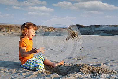 Little girl playing in sand