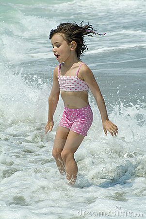 A little girl playing in the sea