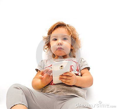 Little girl playing with smartphone