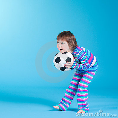 Little girl playing with soccer ball