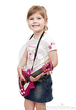 Little girl playing toy pink electric guitar