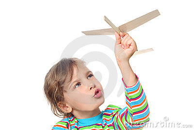 Little girl playing with toy plane