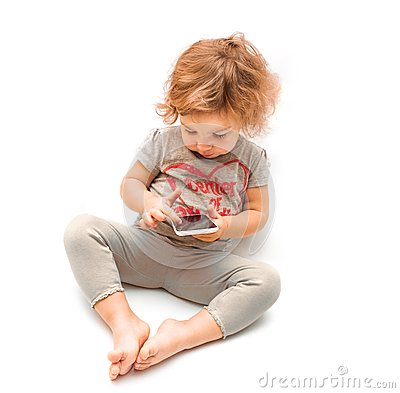 Little girl playing with white smartphone