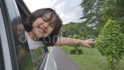 Little Girl Playing on Window Car, Family Traveling on Countryside. Slow motion of little Girl Playing on Window Car, Family Traveling on Countryside stock video