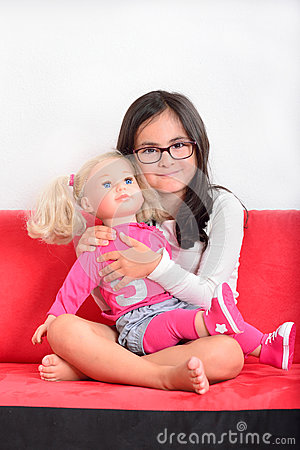 Free Little Girl Playing With A Doll Stock Photo - 44348990