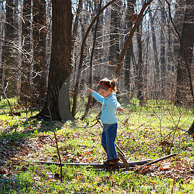 Little Girl Playing In Woods Stock Image - Image: 4888731
